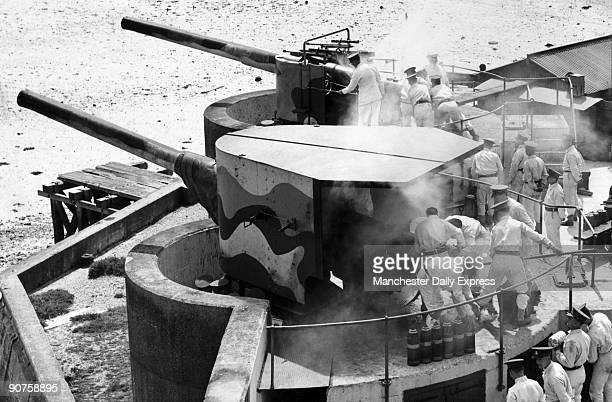 �At first warning of an enemy approach guns will be ready to defend Britain�s coasts� Men of the Coast Artillery School manning 6inch guns in...