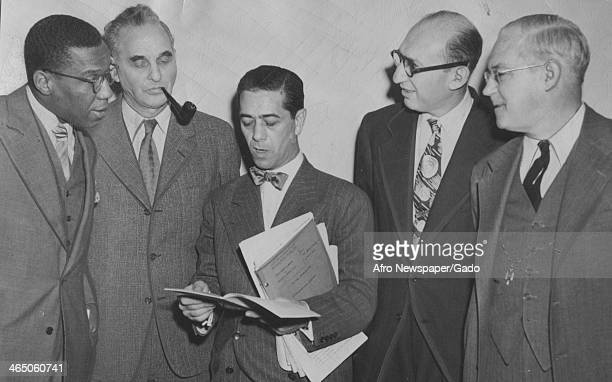 At Foley Square federal courthouse defense attorneys for 12 American Communists on trial hold a corridor conference New York New York October 14 1949...