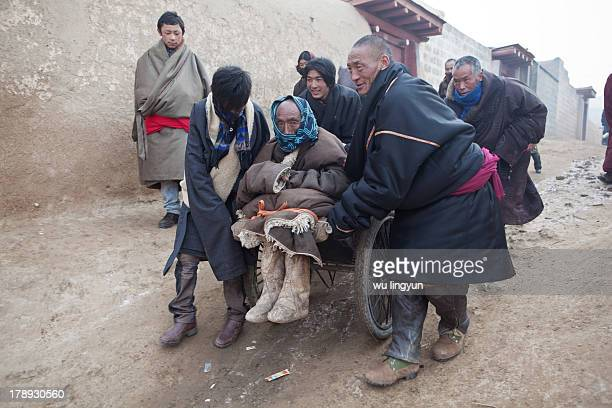 CONTENT] at Gerdeng Monastery in tibetan new year in Aba Tibetan region of Sichuan provincea paralyzed old man in a handcart went to the monastrey to...