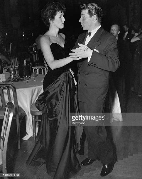 At Gibson Girl Ball New York Movie star Pierre Aumont does some terpsichorean twinkling as he dances with Mrs William Paley at the Gibson Girl Ball...