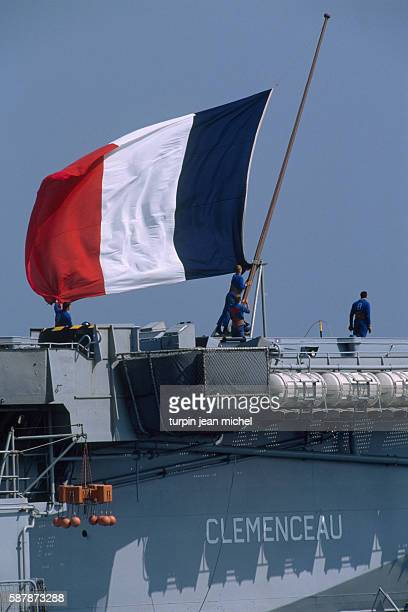 At harbor in Toulon sailors on the aircraft carrier Clemenceau raise the colors of France in preparation for departure in direction of the Persian...
