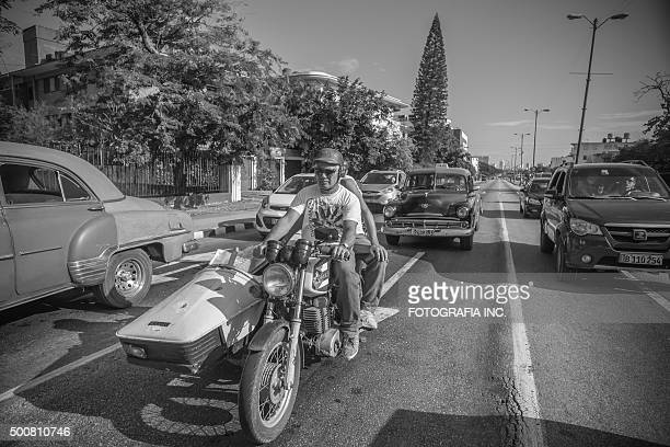 at havana's stop light - women black and white motorcycle stock pictures, royalty-free photos & images