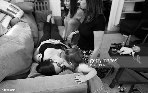At her 4 month checkup Ashley Bennett's two year old daughter Marin leaned over to give her a kiss as she laid on the couch at her Midwife's home in...