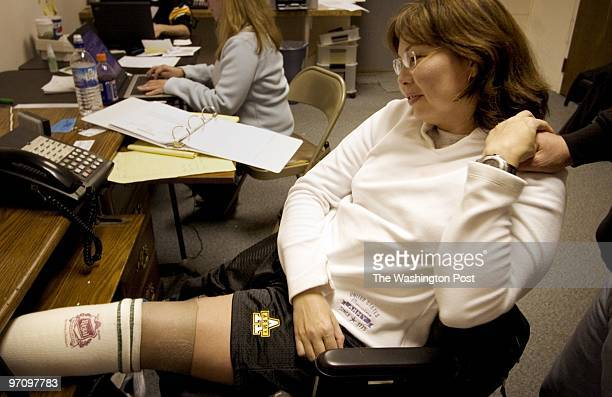 At her campaign headquarters Iraq war veteran Tammy Duckworth shares a moment with her husband Illinois Army Guard Capt Bryan Bowlsbey Maj Ladda...