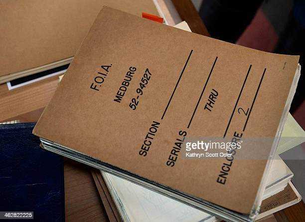 At her home Sarah Davidon looks through page after page of documents her father Bill Davidon collected from the FBI through the Freedom of...
