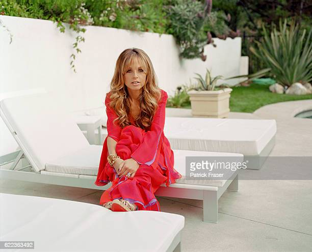 At her Los Angeles home Makeup by Byron Williams and hair by Mark Townsend