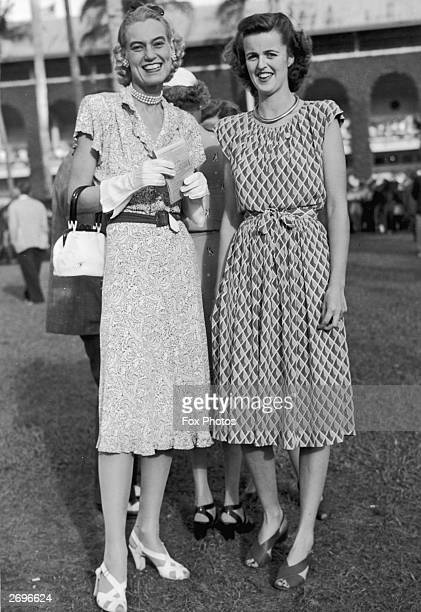 At Hialeah racetrack Florida members of the Social Register Mrs John A Morris from New York and Mrs Edward W C Russell of Washingrton DC They are...