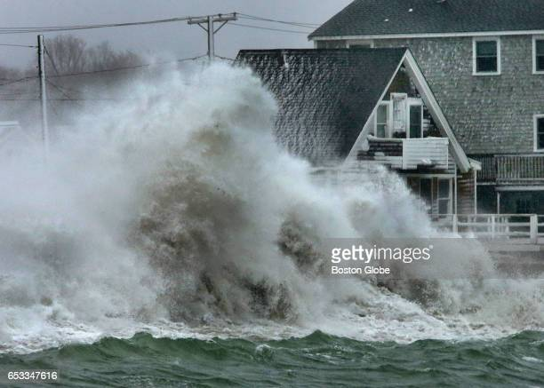 At high tide a huge wave crashes into the seawall protecting homes on Turner Road on Scituate Harbor during a winter storm on Mar 14 2017