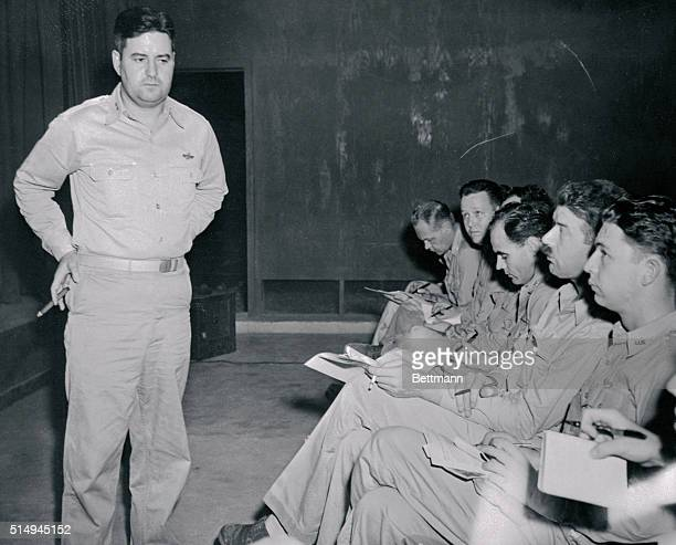 At his headquarters on Guam Major General Curtis E LeMay Commanding General of the 20th Air Force explains to newsmen the new technique employed by...