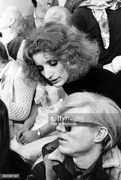 At his Union Square Factory American pop artist Andy Warhol speaks with model and actress Viva during a photoshot in honor of the publication of...