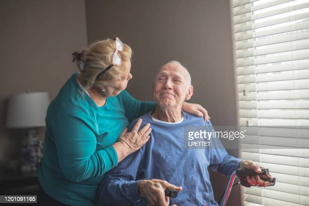 at home care giver - hospice stock pictures, royalty-free photos & images