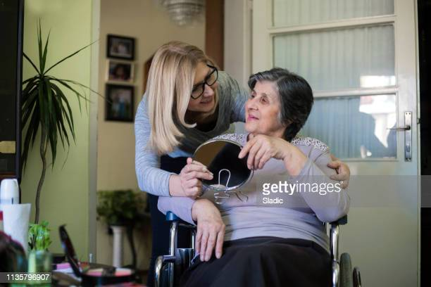 at home caregiver - house call stock pictures, royalty-free photos & images