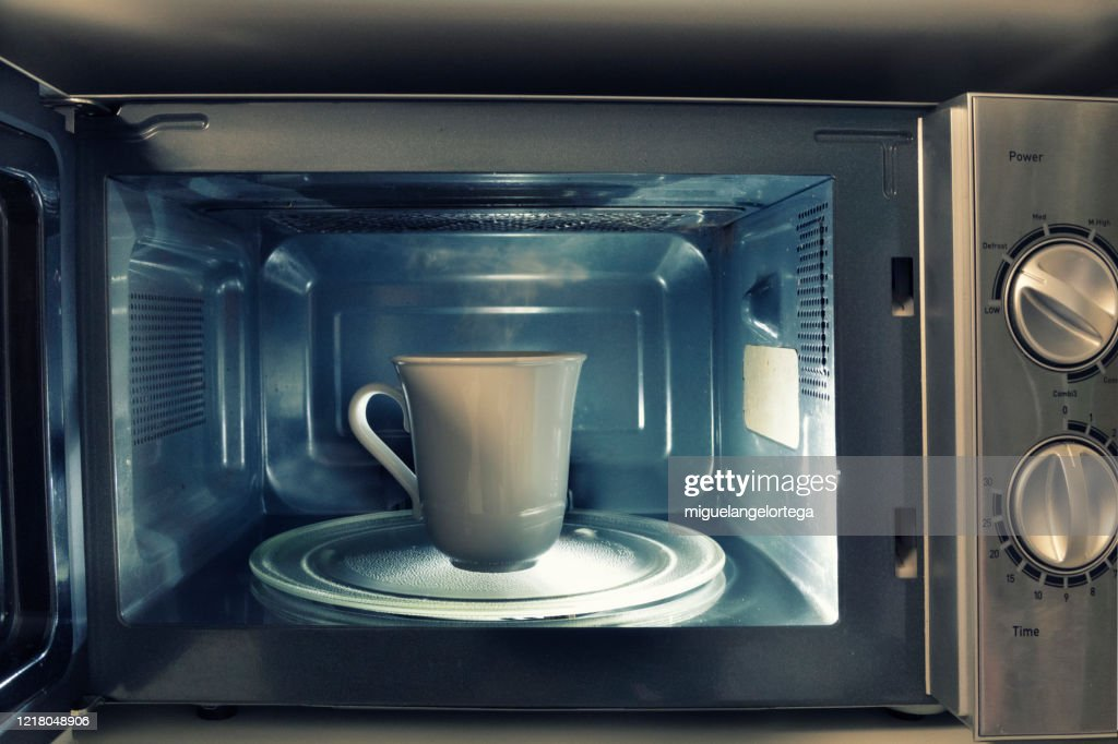 At home still life - A cup inside a microwave : Stock Photo