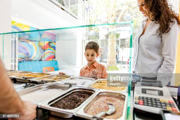 at ice cream parlor - ice cream parlor stock photos and pictures