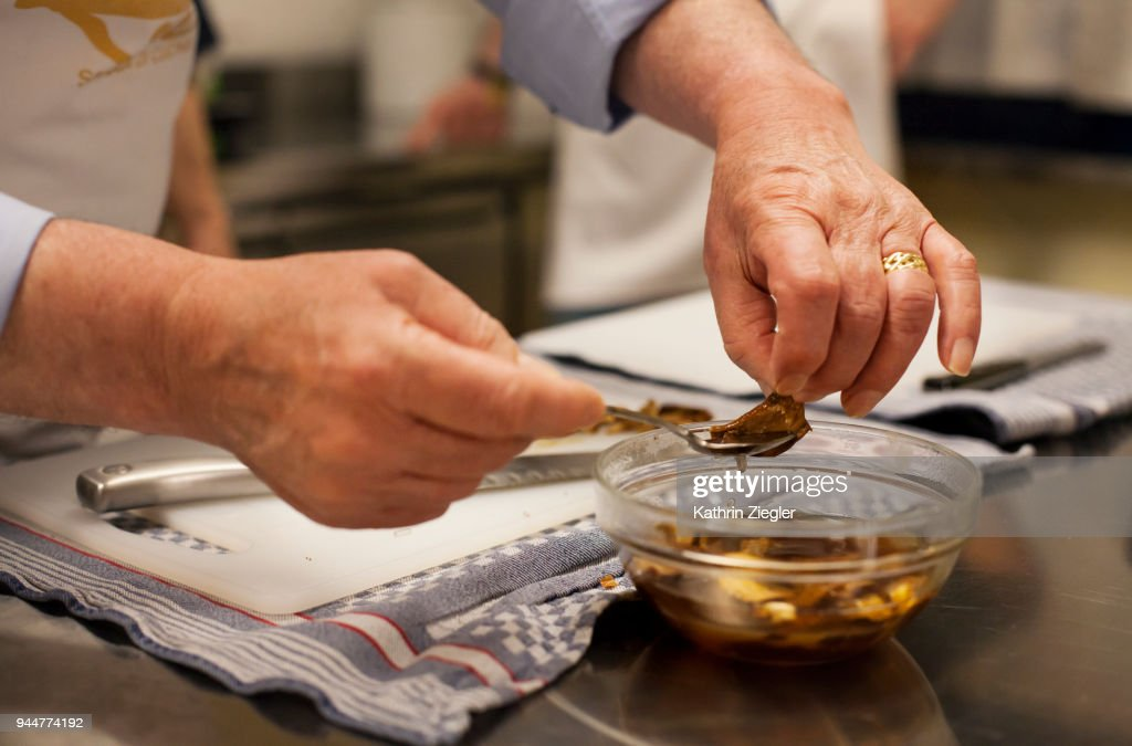 At Italian cooking school: Mushrooms being used for pasta sauce, close-up of man's hands : Stock Photo