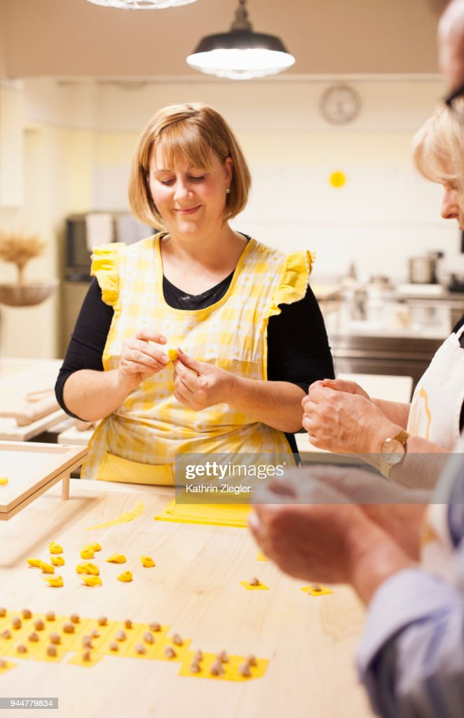 At Italian cooking school: Teacher showing how to make tortellini : Stock Photo