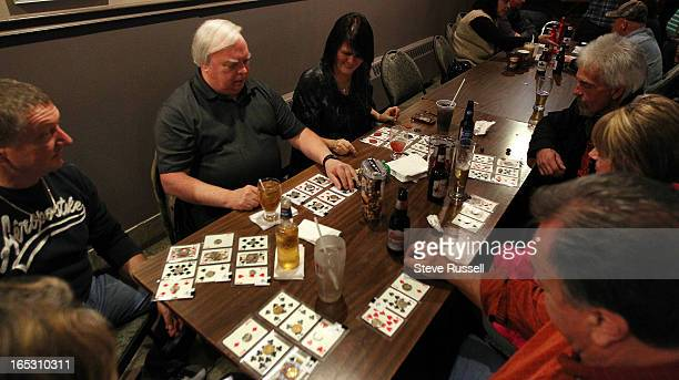 At Jennifer Bain's table at Porketta Bingo at the Beef n Bird in Sudbury Porketta Bingo three cards are laminated together from a deck including the...