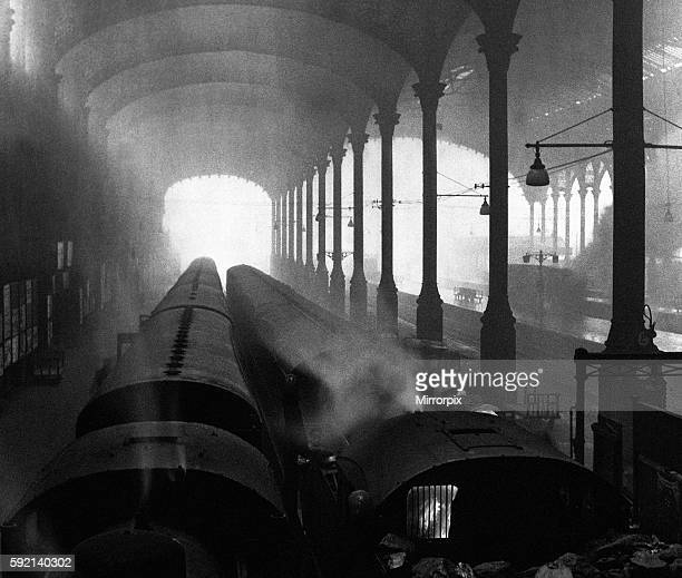 At journeys end for London commuters were sights like this at Liverpool Street, more a cathedral of smog than steam in the 1950s. Trains wait by the...