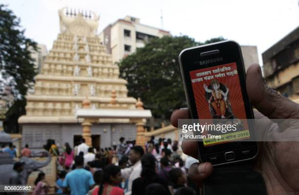 At Lalbagh Sarvajanik Utsav Mandal Ganesh Galli for the first time in the city devotees recieve images of the idol through bluetooth on their mobile...