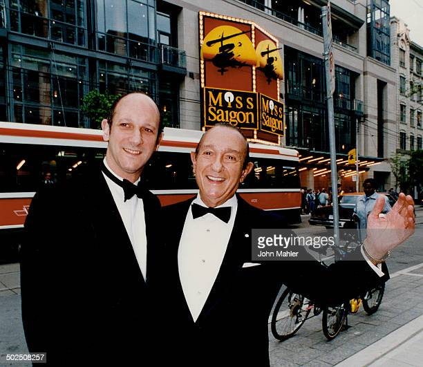At last David and father Ed Mirvish have reason to smile last night as they stand in front of the Princess of Wales Theatre before the Canadian...