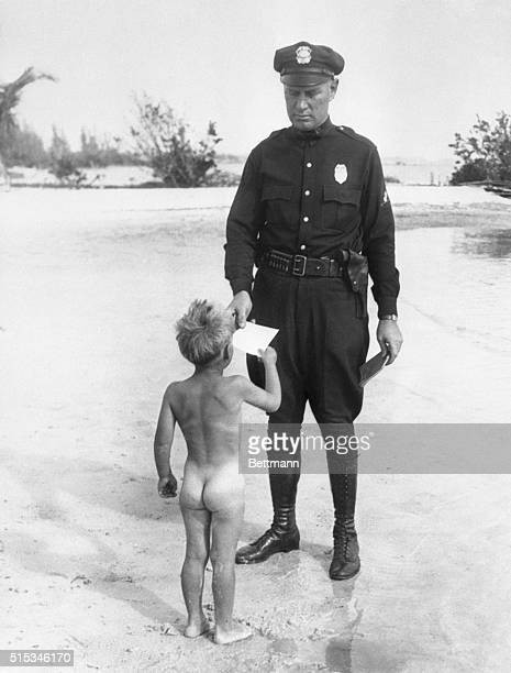 At lastthe bare truth Little Clifford Rogers has been caught playing around in his birthday suit on a public beach at Miami Florida Cop RC Barton is...