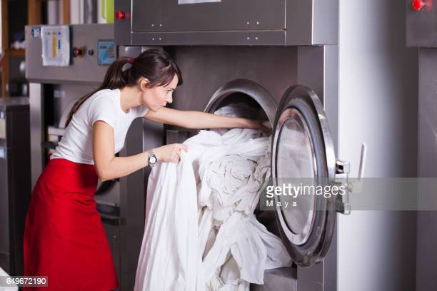 at laundry service. - bedclothes stock pictures, royalty-free photos & images