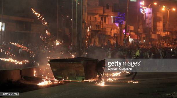 At least 10000 Palestinian protesters marching against Israel's military offensive in the Gaza Strip clash with Israeli soldiers and border police at...