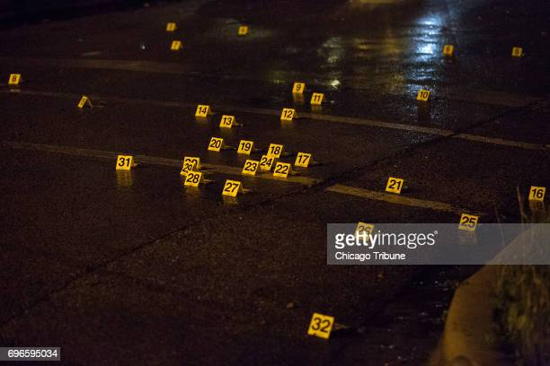 At least 30 evidence markers are scattered at the scene of a fatal shooting in the 5900 block of West Thomas Street Friday June 16 in the Austin...