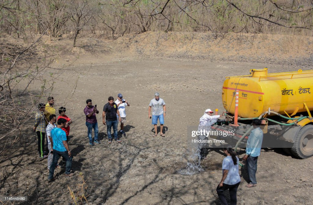 IND: Pune Residents Fill Up A Part Of A Natural Lake, Dried Up Due To The Scorching Heat