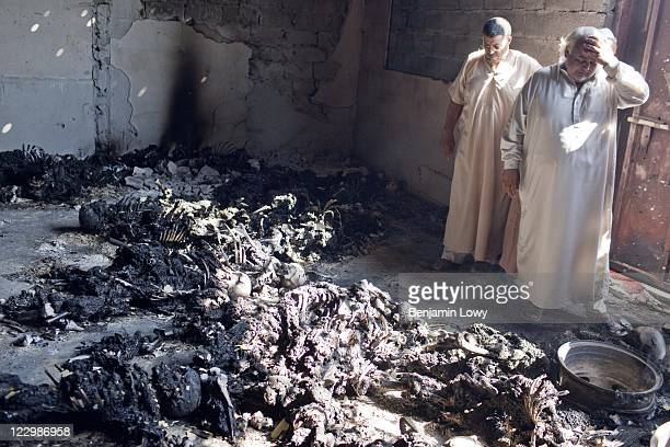 At least 50 burnt bodies were discovered in a construction site shed near the base for the infamous Khamis Brigade on August 27 2011 in Tripoli Libya...