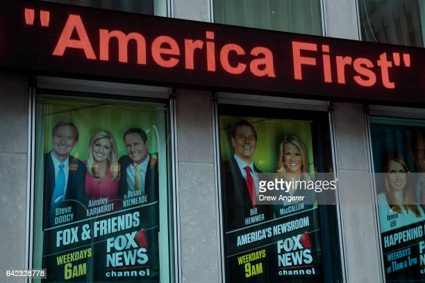 At left an advertisement for 'Fox And Friends' is displayed outside of the Fox News studio February 17 2017 in New York City President Trump a...