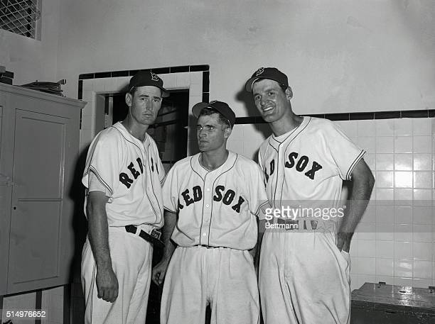 At left is Ted Williams Boston Red Sox slugger as he stands in front of the scoreboard in the first half of the ninth inning of the game against St...