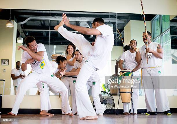 At left Members Amado Carsky and Jonathan Tivade spar with each other in capoeira class inside Roda Movements in Takoma Park Maryland on March 08 2014