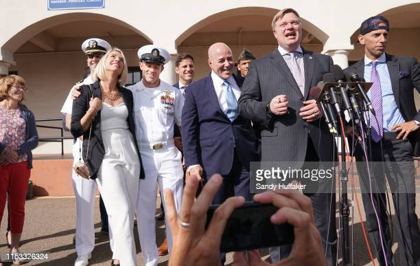 At left Navy Special Operations Chief Edward Gallagher celebrates with his wife Andrea after being acquitted of premeditated murder at Naval Base San...