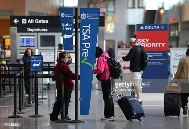 At Logan Airport Terminal a sign points to the new TSA New Pre Check Enrollment Center at Logan Airport The TSA Administrator John S Pistole was on...