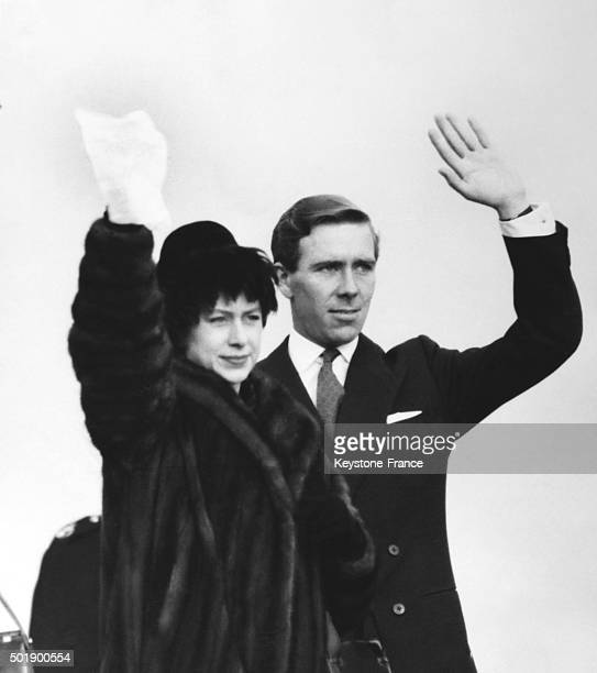 At London airport Princess Margaret with husband Antony Armstrong Jones wave farewell to Queen Elizabeth and Duke of Edinburgh leaving for a tour in...