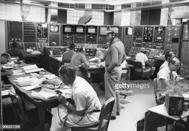At Los Alamos Scientific Laboratory mission control scientists at instrument panels fire a 'Kiwi' A3 nuclear rocket reactor Los Alamos New Mexico...