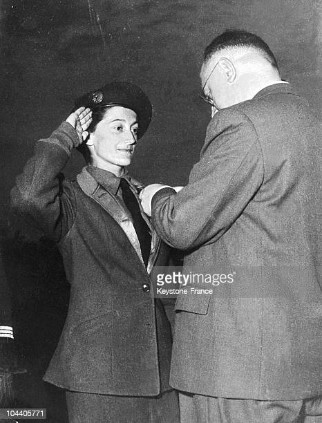 At Mangin stadium in Hanoi Ms Valerie ANDRE neurosurgeon assistant being decorated with the Croix de Guerre on January 31 1952 After her thesis in...