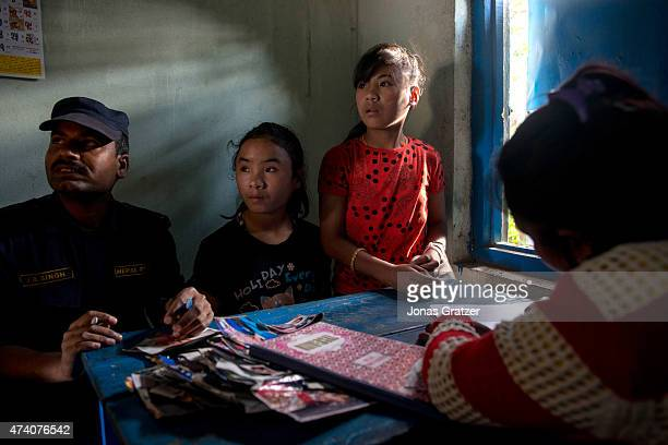 At Mati Nepal's office at the Thankot Checkpoint Mati Nepal's staff and the police interrogate a victim of human trafficking on May 14, 2015 in...