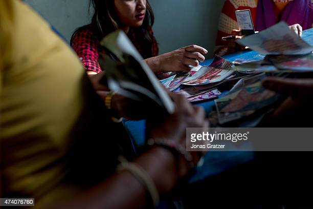 At Mati Nepal's office at the Thankot Checkpoint staff and police interrogate a young woman who is thought to be a victim of human trafficking on May...
