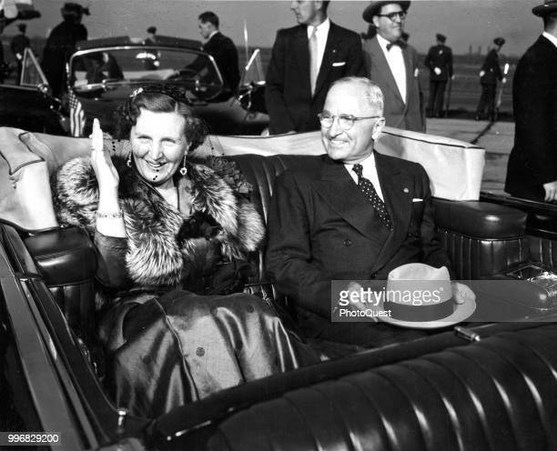 At National Airport, Queen Juliana of the Netherlands and US President Harry S Truman smile as they ride in a convertible during the former's state...