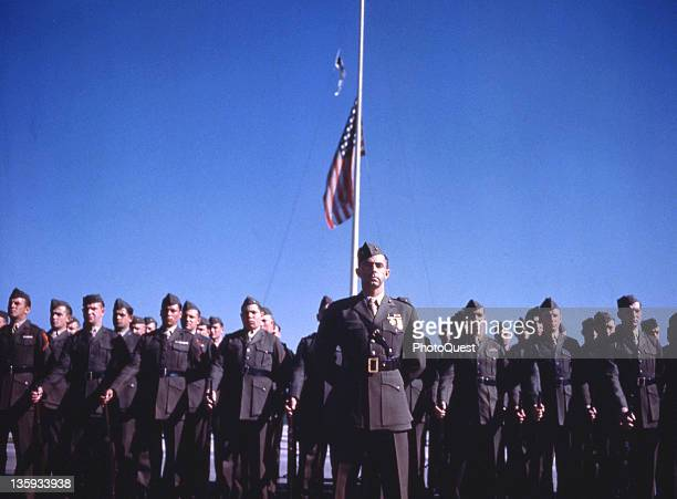 At Naval Air Station Alameda Marines parade before the halfmaster flag during memorial services for the late President Franklin D Roosevelt Alameda...