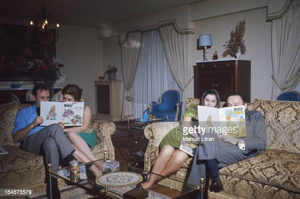 At NeuillysurSeine in Uderzo sitting on sofas in the lounge from left to right Albert Uderzo and his wife Ada Gilberte and her husband Rene Goscinny...