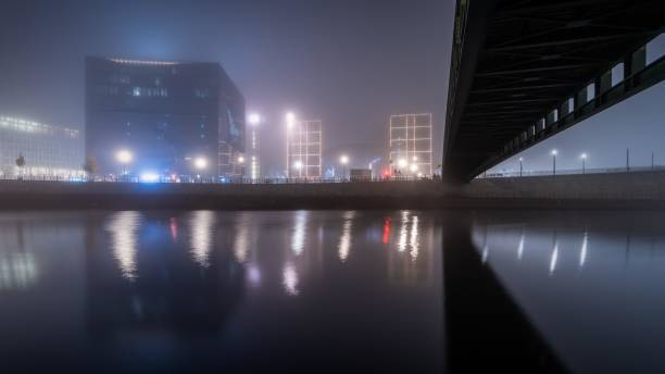 At night at the Gustav-Heinemann-Steg at the central station in the fog, Berlin, Germany