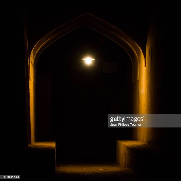 at night in a dark alley of ardakan, yazd province, central iran - black alley stock photos and pictures