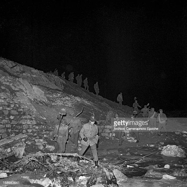 At night soldiers search for survivors among the rubble Longarone near the Vajont Dam in the Piave Valley Italy early October 1963 On October 9 a...