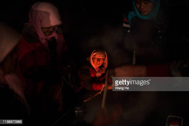 At night the local women cook in the desert at Mingqin county on March 28th 2019 in Wuwei Gansu Province China In order to prevent desertification...