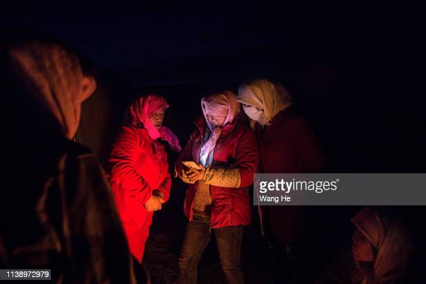 At night the local women uses iphone in the desert at Mingqin county on March 28th 2019 in Wuwei Gansu Province China In order to prevent...