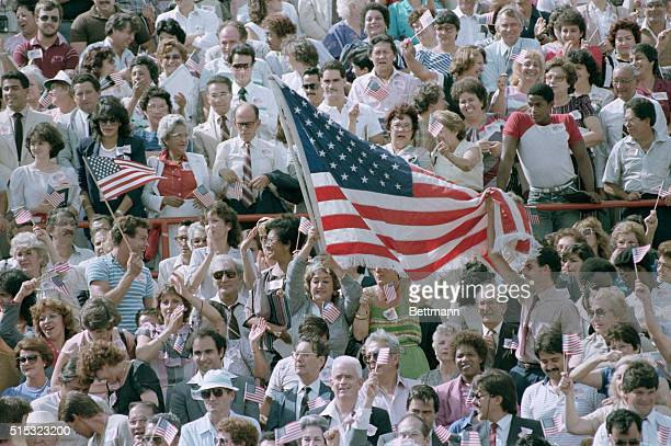 At Orange Bowl Stadium, immigrants demonstrate their patriotism during what could be the largest naturalization ceremony in American history.