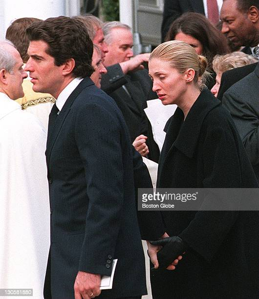 At Our Lady of Victory Church for Michael Kennedy's funeral John F Kennedy Jr and his wife Carolyn Bessette leave the services